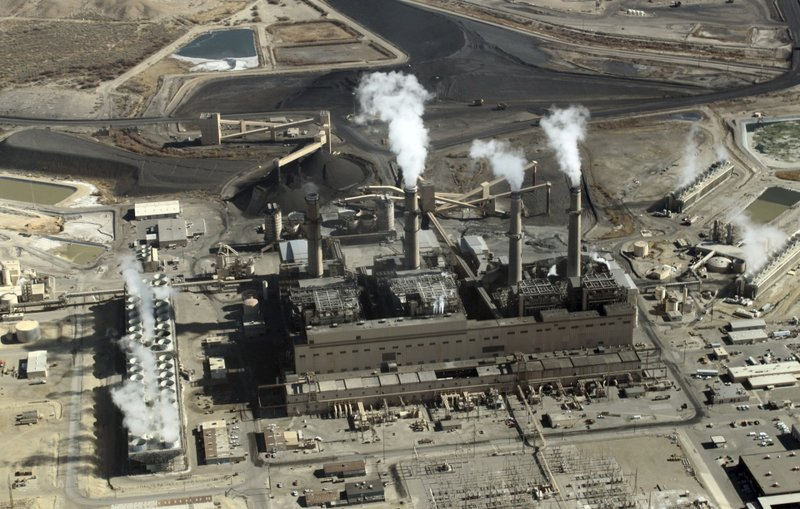 FILE - This Nov. 9, 2009, file photo shows the coal-fired San Juan Generating Station near Farmington, N.M. Proponents of New Mexico's energy industry say emails exchanged among environmentalists and a key member of Gov. Michelle Lujan Grisham's cabinet represent a conflict of interest as the state was creating landmark legislation that set ambitious new renewable energy goals.(AP Photo/Susan Montoya Bryan, File)
