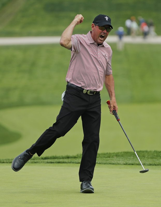 Rich Beem reacts after sinking a putt for birdie on the 18th green during the second round of the PGA Championship golf tournament, Friday, May 17, 2019, at Bethpage Black in Farmingdale, N.Y. (AP Photo/Andres Kudacki)