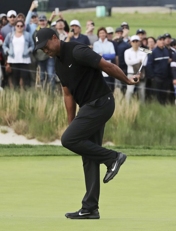 Tiger Woods reacts after missing a putt for birdie on the 17th green during the second round of the PGA Championship golf tournament, Friday, May 17, 2019, at Bethpage Black in Farmingdale, N.Y. (AP Photo/Charles Krupa)