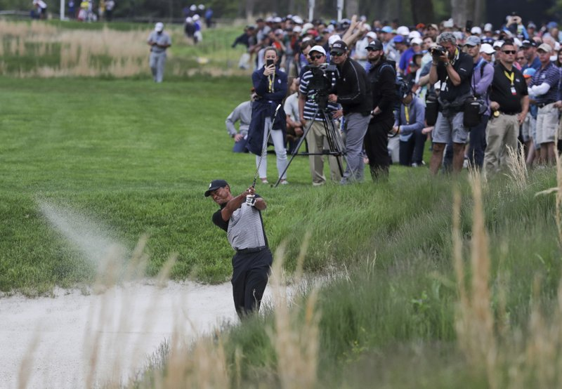 Tiger Woods hits out of a bunker on the 13th hole during the second round of the PGA Championship golf tournament, Friday, May 17, 2019, at Bethpage Black in Farmingdale, N.Y. (AP Photo/Charles Krupa)