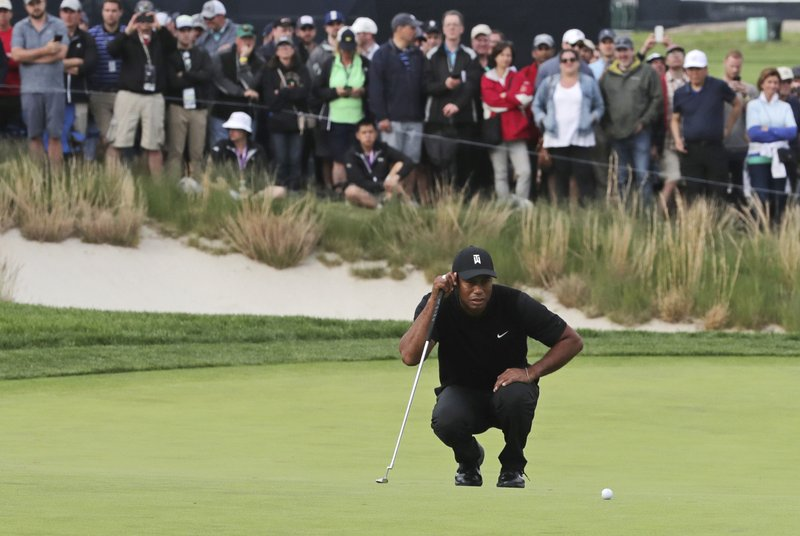 Tiger Woods lines up a putt on the 17th green during the second round of the PGA Championship golf tournament, Friday, May 17, 2019, at Bethpage Black in Farmingdale, N.Y. (AP Photo/Charles Krupa)