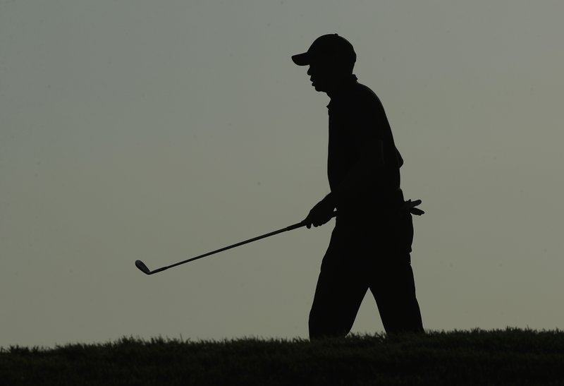 Tiger Woods walks to the 18th green during the second round of the PGA Championship golf tournament, Friday, May 17, 2019, at Bethpage Black in Farmingdale, N.Y. (AP Photo/Andres Kudacki)