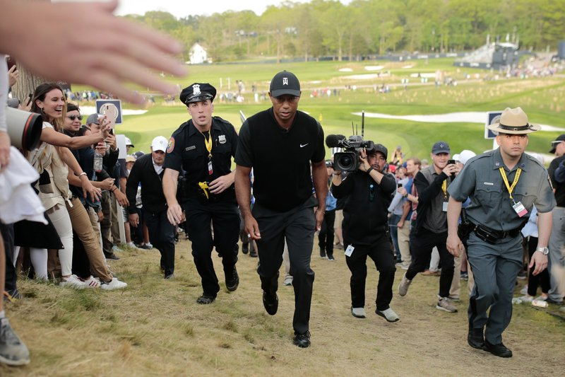 Tiger Woods walks up to the 18th tee during the second round of the PGA Championship golf tournament, Friday, May 17, 2019, at Bethpage Black in Farmingdale, N.Y. (AP Photo/Andres Kudacki)
