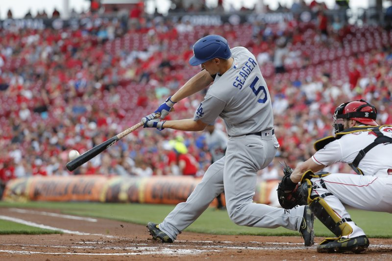 Los Angeles Dodgers' Corey Seager hits a two-run home run off Cincinnati Reds starting pitcher Anthony DeSclafani in the second inning of a baseball game, Friday, May 17, 2019, in Cincinnati. (AP Photo/John Minchillo)