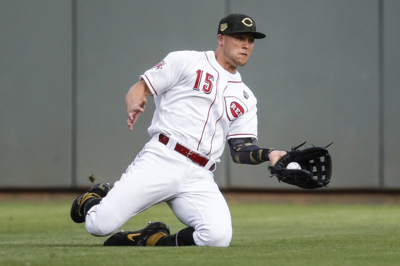 Cincinnati Reds third baseman Nick Senzel catches a fly ball hit by Los Angeles Dodgers' Los Angeles Dodgers' Max Muncy for an out in the first inning of a baseball game, Friday, May 17, 2019, in Cincinnati. (AP Photo/John Minchillo)