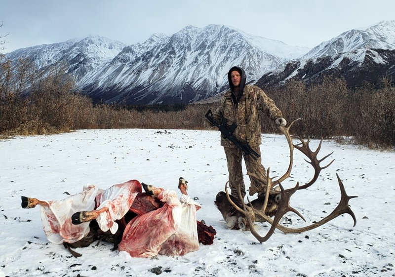 This 2018 photo provided by Aleksandr Neverov shows Viacheslav Akimenko on a caribou hunt near Glennallen, Alaska. Akimenko left the men's hunting camp in early May near Kodiak, Alaska, and Neverov found his friend's body six days later, about a mile from camp with no apparent signs the man was mauled by a bear or harmed himself. (Aleksandr Neverov via AP).