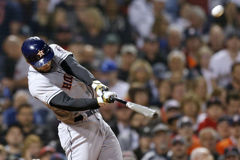 Houston Astros' George Springer hits a two-run home run during the eighth inning of the team's baseball game against the Boston Red Sox in Boston, Friday, May 17, 2019. (AP Photo/Michael Dwyer)