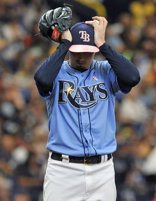 Tampa Bay Rays starter Blake Snell adjusts his cap between pitches during the fifth inning of a baseball game against the New York Yankees, Sunday, May 12, 2019, in St. Petersburg, Fla. (AP Photo/Steve Nesius)