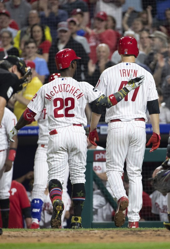 Philadelphia Phillies' Andrew McCutchen, left, celebrates his two-run home run with Cole Irvin during the third inning of the team's baseball game against the Colorado Rockies, Friday, May 17, 2019, in Philadelphia. (AP Photo/Chris Szagola)
