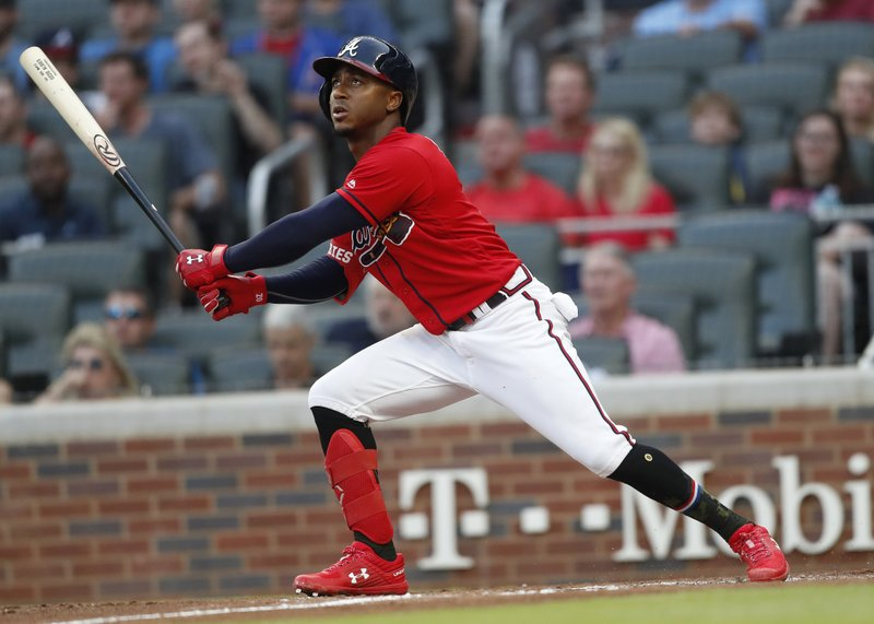 Atlanta Braves' Ozzie Albies watches his RBI sacrifice fly during the second inning of the team's baseball game against the Milwaukee Brewers on Friday, May 17, 2019, in Atlanta. (AP Photo/John Bazemore)