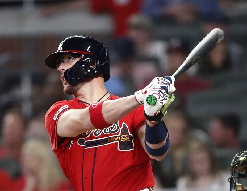 Atlanta Braves' Tyler Flowers follows through on a home run during the sixth inning of the team's baseball game against the Milwaukee Brewers on Friday, May 17, 2019, in Atlanta. (AP Photo/John Bazemore)