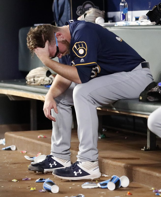 Milwaukee Brewers starting pitcher Corbin Burnes sits on the bench after being removed during the sixth inning of the team's baseball game against the Atlanta Braves on Friday, May 17, 2019, in Atlanta. (AP Photo/John Bazemore)
