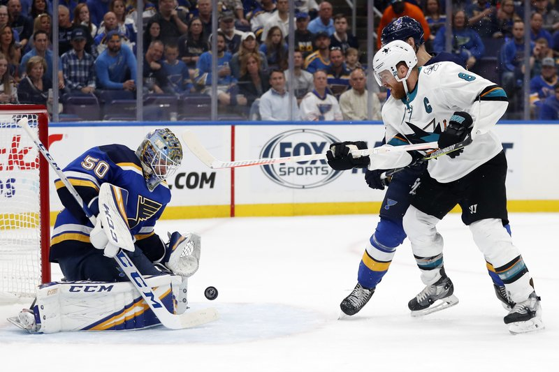 San Jose Sharks center Joe Pavelski (8) watches for the rebound as St. Louis Blues goaltender Jordan Binnington (50) blocks a shot during the second period in Game 4 of the NHL hockey Stanley Cup Western Conference final series Friday, May 17, 2019, in St. Louis. (AP Photo/Jeff Roberson)
