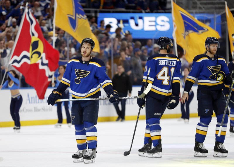 St. Louis Blues players are cheered after beating the San Jose Sharks in Game 4 of the NHL hockey Stanley Cup Western Conference final series Friday, May 17, 2019, in St. Louis. The Blues won 2-1 to even the series 2-2. (AP Photo/Jeff Roberson)