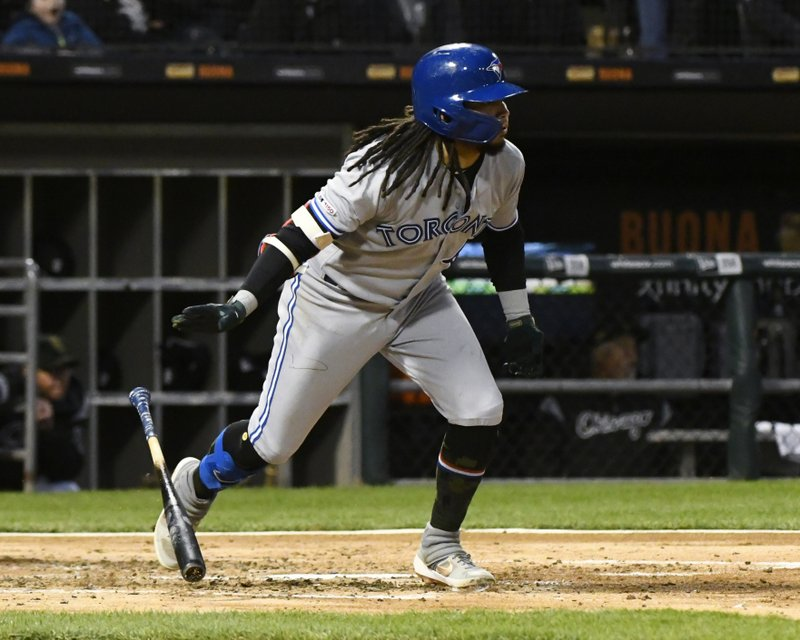 Toronto Blue Jays' Freddy Galvis runs to first base after hitting an RBI single during the third inning of the team's baseball game against the Chicago White Sox on Friday, May 17, 2019, in Chicago. (AP Photo/Matt Marton)