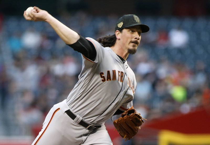 San Francisco Giants starting pitcher Jeff Samardzija throws against the Arizona Diamondbacks during the first inning of a baseball game, Friday, May 17, 2019, in Phoenix. (AP Photo/Ralph Freso)