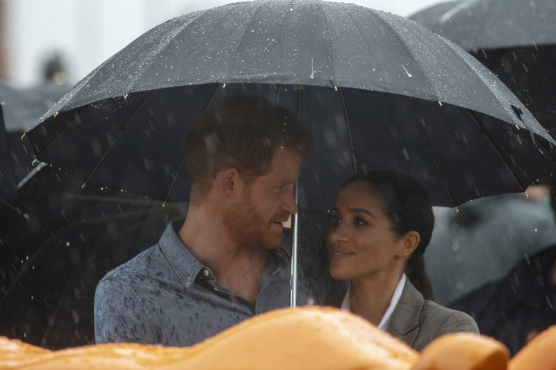 FILE - In this Wednesday, Oct. 17, 2018 file photo, Britain's Prince Harry and Meghan, Duchess of Sussex attend a community picnic at Victoria Park in Dubbo, Australia. Sunday, May 19, 2019 marks the first wedding anniversary of the besotted couple. (Ian Vogler/Pool via AP, File)