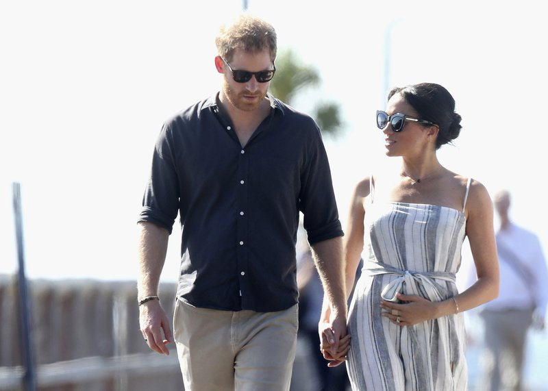 File - In this Monday, Oct. 22, 2018 file photo, Britain's Prince Harry and Meghan, Duchess of Sussex walk along the Kingfisher Bay Jetty,  in Fraser Island, Australia. Sunday, May 19, 2019 marks the first wedding anniversary of the besotted couple. (Chris Jackson/Pool Photo via AP, File)