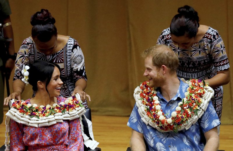 FILE - In this Wednesday, Oct. 24, 2018 file photo, Britain's Prince Harry and Meghan, Duchess of Sussex visit the University of the South Pacific in Suva, Fiji. Sunday, May 19, 2019 marks the first wedding anniversary of the besotted couple. (Phil Noble/Pool Photo via AP, File)