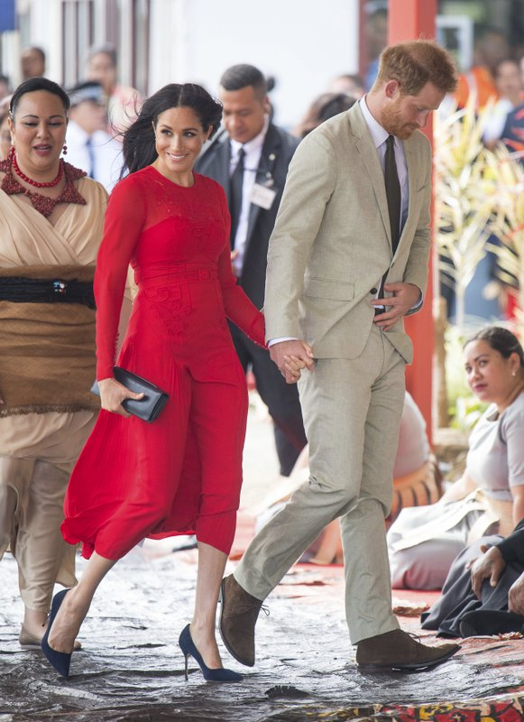 FILE - In this Thursday, Oct. 25, 2019 file photo, Britain's Prince Harry and Meghan, Duchess of Sussex in arrive at Fua'amotu Airport in Tonga. Sunday, May 19, 2019 marks the first wedding anniversary of the besotted couple.  (Dominic Lipinski/Pool Photo via AP, File)