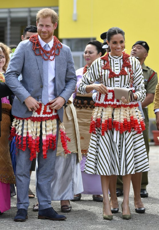 FILE - In this Friday, Oct. 26, 2018 file photo, Britain's Prince Harry and Meghan, the Duchess of Sussex visit an exhibition of Tongan handicrafts, mats and tapa cloths at the Fa'onelua Convention Centre in Nuku'alofa, Tonga. Sunday, May 19, 2019 marks the first wedding anniversary of the besotted couple.  (Dominic Lipinski/Pool Photo via AP, File)