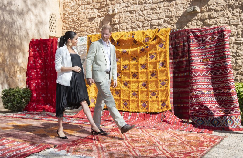 File - In this Monday, Feb. 25, 2019 file photo, Britain's Prince Harry and Meghan, Duchess of Sussex visit the Andalusian Gardens in Rabat, Morocco. Sunday, May 19, 2019 marks the first wedding anniversary of the besotted couple. (Facundo Arrizabalaga/Pool Photo via AP, File)