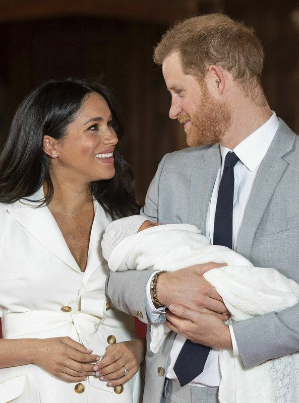 FILE - In this Wednesday, May 8, 2019 file photo, Britain's Prince Harry and Meghan, Duchess of Sussex smile during a photocall with their newborn son, in St George's Hall at Windsor Castle, Windsor, south England. Sunday, May 19, 2019 marks the first wedding anniversary of the besotted couple. (Dominic Lipinski/Pool via AP, File)