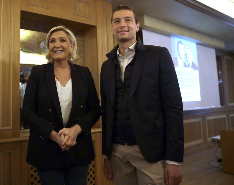Leader of the French National Front Marine Le Pen, left, and Far-right top candidate of the French National Rally party Jordan Bardella leave after a press conference ahead of a rally with right-wing EU leaders in Milan, Italy, Saturday, May 18, 2019. (AP Photo/Luca Bruno)