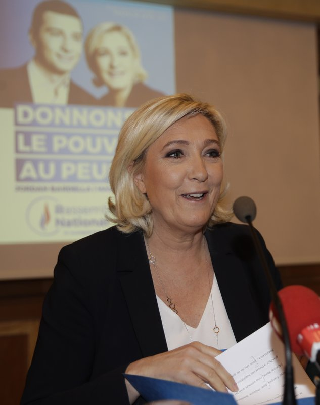 Leader of the French National Front Marine Le Pen leaves at the end of a press conference ahead of a rally with right-wing EU leaders in Milan, Italy, Saturday, May 18, 2019. (AP Photo/Luca Bruno)