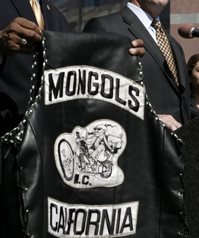 FILE - In this Oct. 21, 2008, file photo, a the Mongols motorcycle club's logo is displayed at a news conference in Los Angeles. A federal judge on Friday, May 17, 2019, fined the Mongols motorcycle club $500,000 in a racketeering and conspiracy case but refused the latest effort in a decade-long attempt by the government to take away the club's control over its logo — a Genghis Khan-style rider in sunglasses astride a chopper-style bike. (AP Photo/Ric Francis, File)