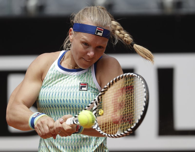 Kiki Bertens of the Netherlands returns the ball to Johanna Konta of Britain during a semifinal match at the Italian Open tennis tournament, in Rome, Saturday, May 18, 2019. (AP Photo/Andrew Medichini)