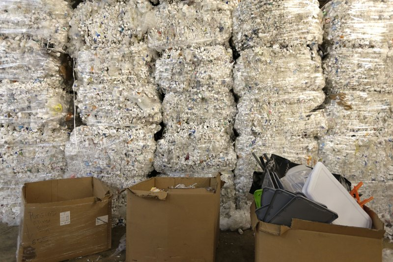 In this May 7, 2019 photo, plastic pill bottles are bundled for recycling at a GDB International warehouse in Monmouth Junction, N.J. According to GDB International president Sunil Bagaria, the domestic processing capacity of recyclable materials will need to increase as a growing number of countries restrict scrap imports.  (AP Photo/Seth Wenig)