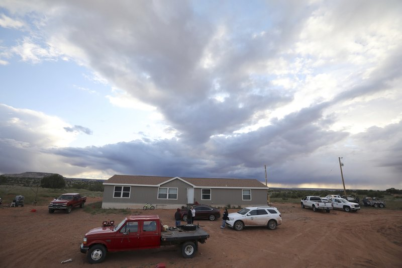 This Wednesday, May 8, 2019 photo shows the mobile home where Miranda Haskie has lived with her husband, Jimmie Long Jr. and son, Jayden Long, 13, in Kaibeto on the Navajo Reservation for more than a decade without mains electricity. On Thursday, May 9, 2019 their isolated home was connected to the grid. An ambitious project to connect homes to the electric grid on the country's largest American Indian reservation is wrapping up. Utility crews from across the U.S. have volunteered their time over the past few weeks to hook up about 300 homes on the Navajo Nation. (AP Photo/Jake Bacon)