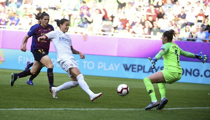 Barcelona goalkeeper Sandra Panos, right, receives a goal by Dzsenifer Marozsan of Lyon, second left, during the women's soccer UEFA Champions League final match between Olympique Lyon and FC Barcelona at the Groupama Arena in Budapest, Hungary, Saturday, May 18, 2019. (Tibor Illyes/MTI via AP)