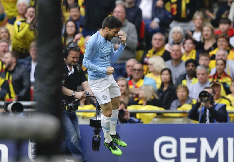 Manchester City's David Silva celebrates after scoring his side's first goal during the English FA Cup Final soccer match between Manchester City and Watford at Wembley stadium in London, Saturday, May 18, 2019. (AP Photo/Kirsty Wigglesworth)