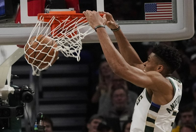 Milwaukee Bucks' Giannis Antetokounmpo dunks during the second half of Game 2 of the NBA Eastern Conference basketball playoff finals against the Toronto Raptors Friday, May 17, 2019, in Milwaukee. The Bucks won 125-103 to take a 2-0 lead in the series. (AP Photo/Morry Gash)
