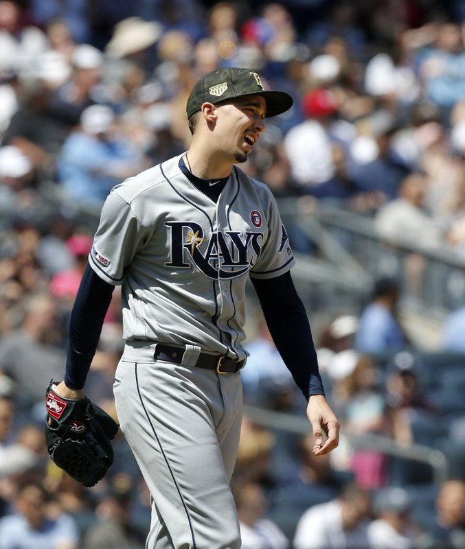 Tampa Bay Rays starting pitcher Blake Snell reacts after walking New York Yankees' Luke Voit to load the bases in the third inning of a baseball game, Saturday, May 18, 2019, in New York. (AP Photo/Jim McIsaac)