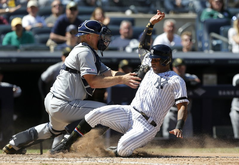 New York Yankees' Aaron Hicks, right, is tagged out at the plate by Tampa Bay Rays catcher Erik Kratz ending the sixth inning of a baseball game, Saturday, May 18, 2019, in New York. Hicks tried to score from second base on a base hit by Gleyber Torres. (AP Photo/Jim McIsaac)