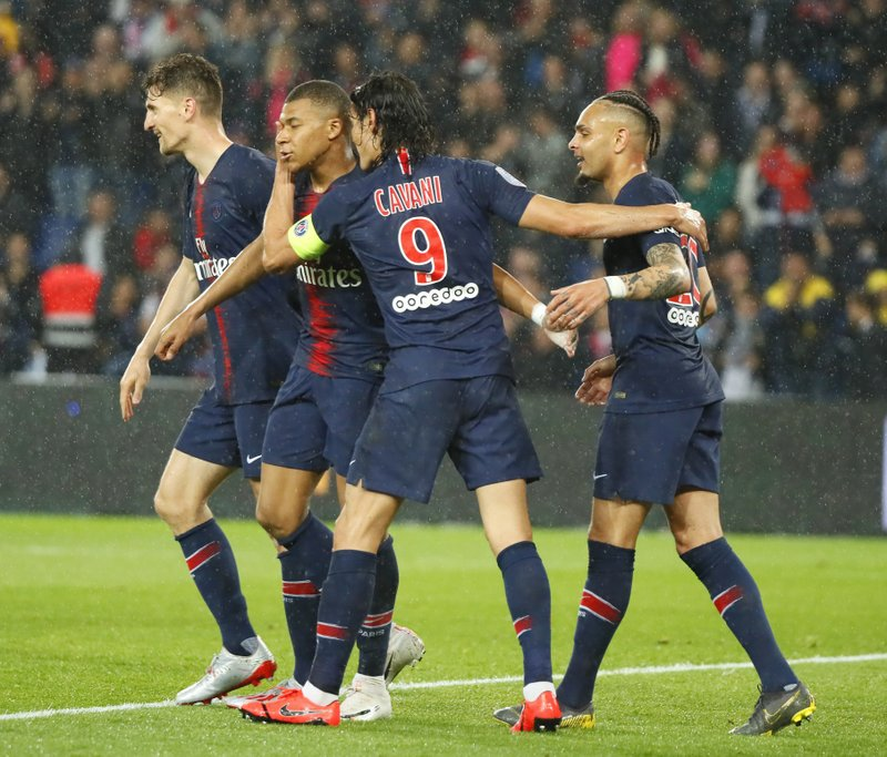 PSG's Kylian Mbappe, second left, celebrates with teammates after scoring his side's third goal during their League One soccer match between Paris Saint Germain and Dijon at the Parc des Princes stadium in Paris, France, Saturday, May 18, 2019. (AP Photo/Francois Mori)