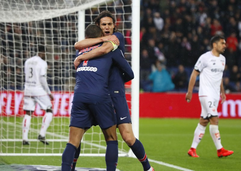 PSG's Kylian Mbappe celebrates with PSG's Edinson Cavani after scoring his side's fourth goal during their League One soccer match between Paris Saint Germain and Dijon at the Parc des Princes stadium in Paris, France, Saturday, May 18, 2019. (AP Photo/Francois Mori)