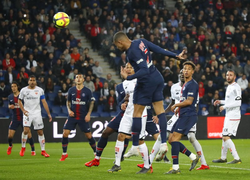 PSG's Kylian Mbappe heads the ball during their League One soccer match between Paris Saint Germain and Dijon at the Parc des Princes stadium in Paris, France, Saturday, May 18, 2019. (AP Photo/Francois Mori)