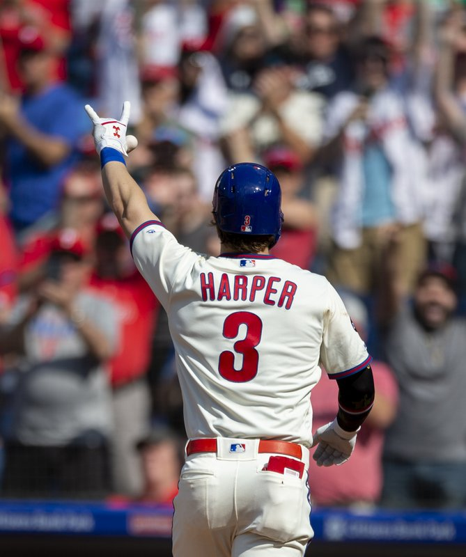 Philadelphia Phillies' Bryce Harper (3) waves to the stands after hitting a home run on Colorado Rockies starting pitcher Antonio Senzatela during the first inning of a baseball game, Saturday, May 18, 2019, in Philadelphia. (AP Photo/Laurence Kesterson)