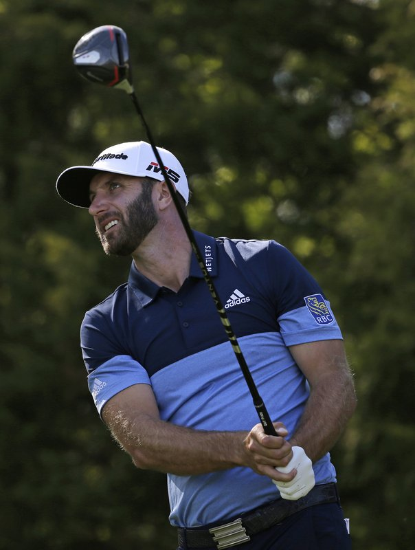Dustin Johnson drives off the 11th tee during the third round of the PGA Championship golf tournament, Saturday, May 18, 2019, at Bethpage Black in Farmingdale, N.Y. (AP Photo/Seth Wenig)