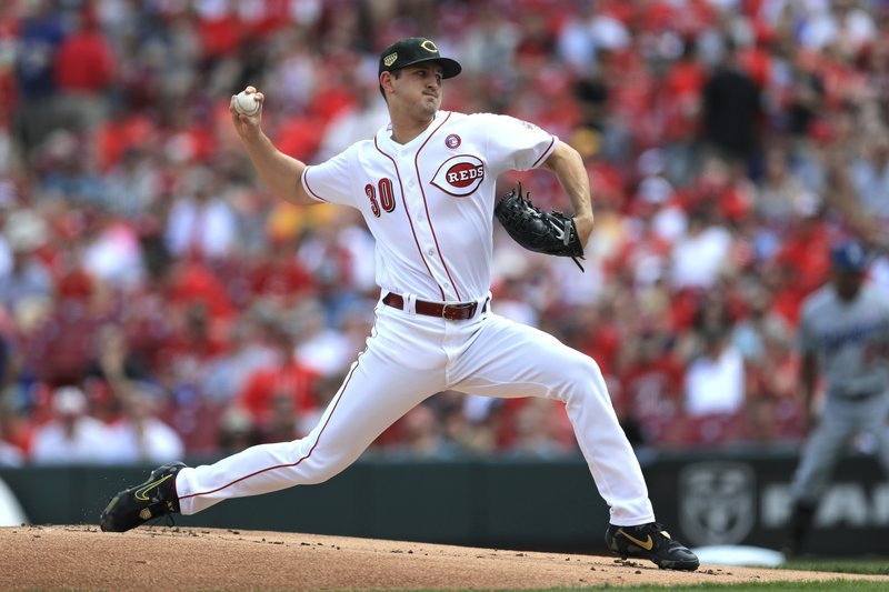 Cincinnati Reds' Tyler Mahle throws in the first inning of a baseball game against the Los Angeles Dodgers, Saturday, May 18, 2019, in Cincinnati. (AP Photo/Aaron Doster)