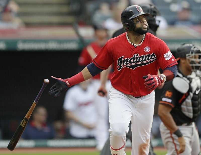Cleveland Indians' Carlos Santana watches his solo home run in the eighth inning of a baseball game against the Baltimore Orioles, Saturday, May 18, 2019, in Cleveland. The Indians won 4-1. (AP Photo/Tony Dejak)