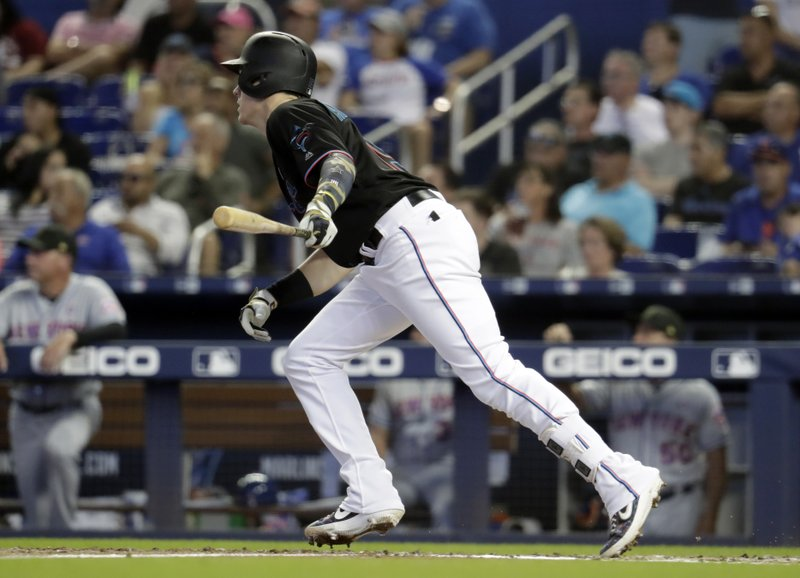Miami Marlins' Brian Anderson hits an RBI-single to score Jon Berti in the third inning during a baseball game against the New York Mets, Saturday, May 18, 2019, in Miami. (AP Photo/Lynne Sladky)