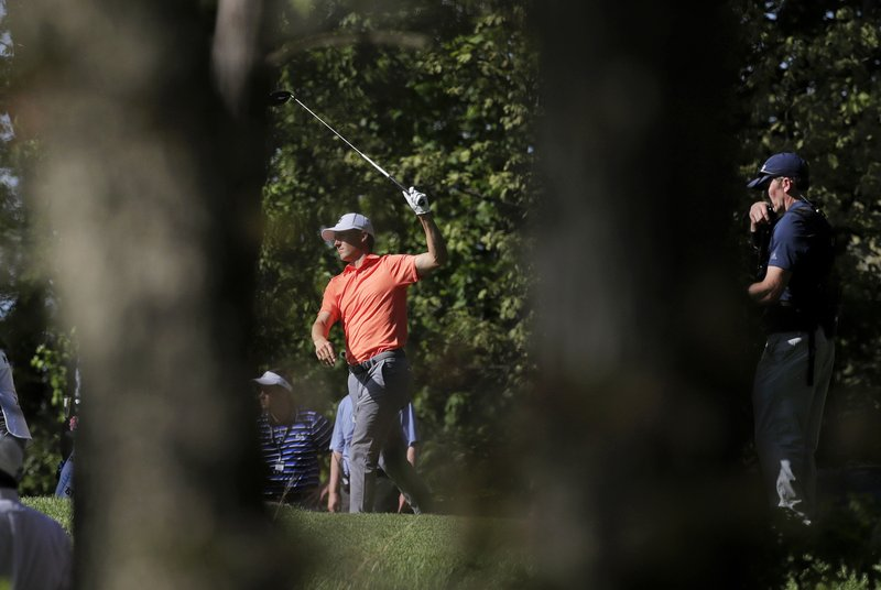 Jordan Spieth hits off the ninth tee during the third round of the PGA Championship golf tournament, Saturday, May 18, 2019, at Bethpage Black in Farmingdale, N.Y. (AP Photo/Julio Cortez)