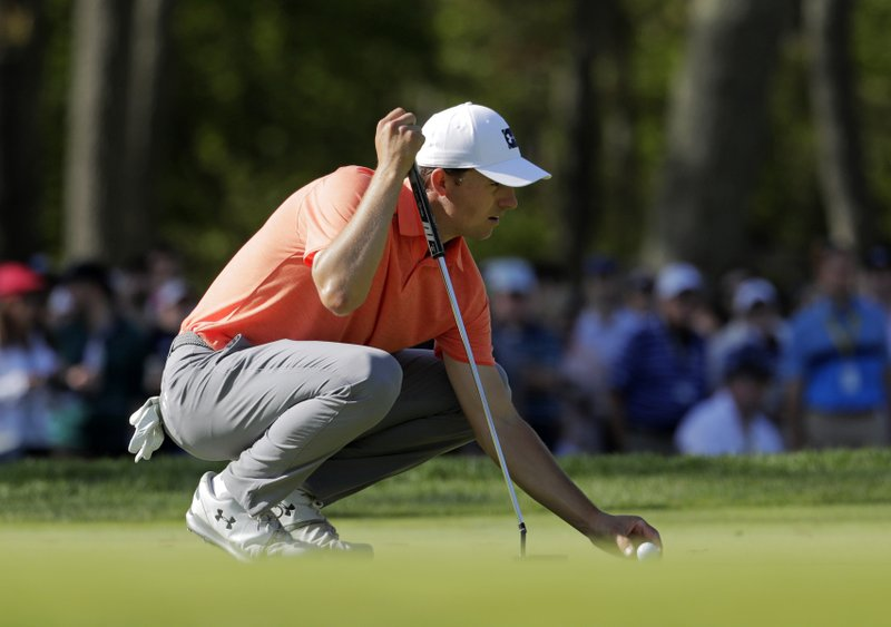 Jordan Spieth lines up a putt on the ninth green during the third round of the PGA Championship golf tournament, Saturday, May 18, 2019, at Bethpage Black in Farmingdale, N.Y. (AP Photo/Julio Cortez)