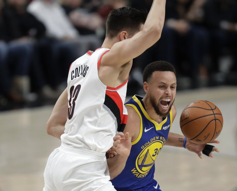 Golden State Warriors guard Stephen Curry, right, is fouled by Portland Trail Blazers forward Zach Collins, left, during the first half of Game 3 of the NBA basketball playoffs Western Conference finals, Saturday, May 18, 2019, in Portland, Ore. (AP Photo/Ted S. Warren)