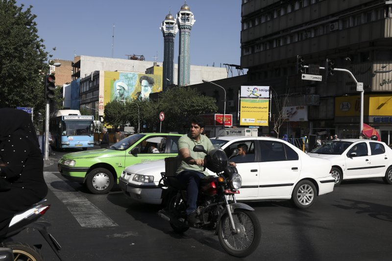 In this Saturday, May 18, 2019 photo, vehicles cross an intersection in downtown Tehran, Iran. (AP Photo/Vahid Salemi)